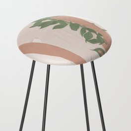 Holding on to a Branch Counter Stool
