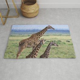 Majestic Giraffe Family Relaxing in Kenya, Africa Rug