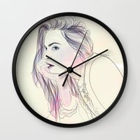 cara Wall Clocks featuring Cara by Guadalupe Jiménez