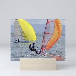 Children Sailing small colourful sailboats with yellow and orange sails. Mini Art Print