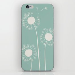 Pale dandelions and flying seeds iPhone Skin