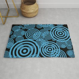 Hypnotizing circles - blue on black Rug