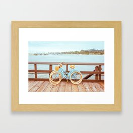 Two retro bicycles standing on Santa Barbara pier, California, USA. Vintage filter with muted teal blue and orange colors. Framed Art Print
