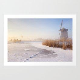 Dutch windmills in a foggy winter landscape in the morning Art Print