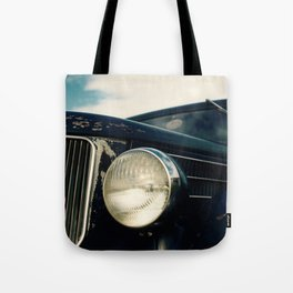 Close-up Photo of a Vintage Car Headlight and Grill Tote Bag