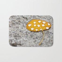 Snowflakes Melt on Golden Aspen Leaf Bath Mat