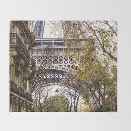 Eiffel Tower in Between Buildings Throw Blanket