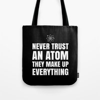 physics Tote Bags featuring NEVER TRUST AN ATOM THEY MAKE UP EVERYTHING (Black & White) by CreativeAngel