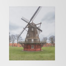 Ancient windmill from the main wooden structure and the base of red color Throw Blanket