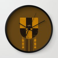 hufflepuff Wall Clocks featuring hufflepuff crest by nisimalotse