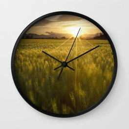 Sunset over a wheat field Wall Clock