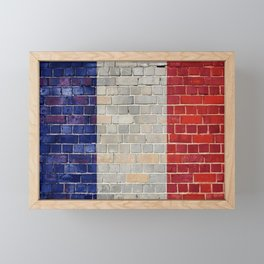 France flag on a brick wall Framed Mini Art Print