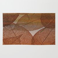blankets Area & Throw Rugs featuring Painterly Amber And Brown Leaf Abstract by Judy Palkimas