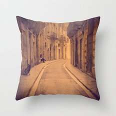 The dog in the narrow street of Barcelona Throw Pillow