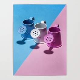 Three small watering cans on a colored background Poster