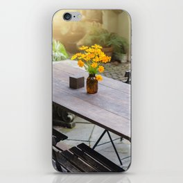Dining-wooden-table-in-the-outdoor iPhone Skin