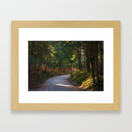 Curved rural road with speed limit sign Framed Art Print