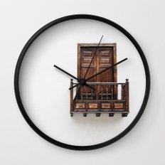 Wooden window door and balcony in a white wall. La Palma, Canary Island. Wall Clock