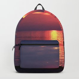 Holes in the Clouds, sunset on the water Backpack