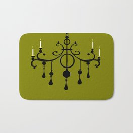 A Chandler with Candles and a Green Background Bath Mat