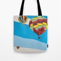 hot air balloons Tote Bags featuring Three Hot Air Balloons by Shelley Chandelier