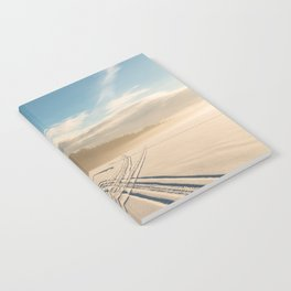 Crossing tracks on snow covered frozen lake Notebook