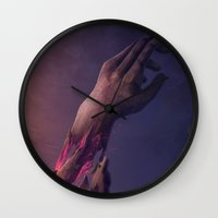 the cure Wall Clocks featuring The Miraculous Cure by Ian Vicknair