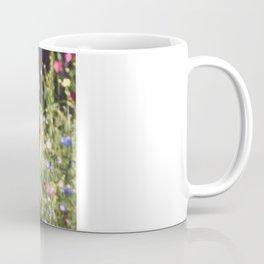 A floral spot on Earth Coffee Mug
