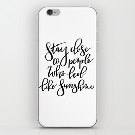 Stay close to people who feel like sunshine black lettering iPhone Skin