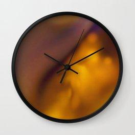 Fluid dreams of warmth Wall Clock
