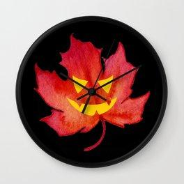 Jack-o-lantern face on a Fall Maple Leaf Wall Clock