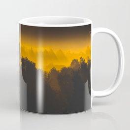 Sunrise behind foggy trees Coffee Mug