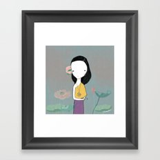 Girl with water lilies Framed Art Print
