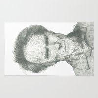 clint eastwood Area & Throw Rugs featuring Clint Eastwood by theMAINsketch