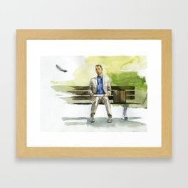 Forrest Gump (Tom Hanks) sitting on a bench with a flying feather Framed Art Print