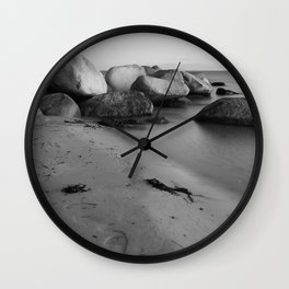 Stones in the sea 3 Wall Clock