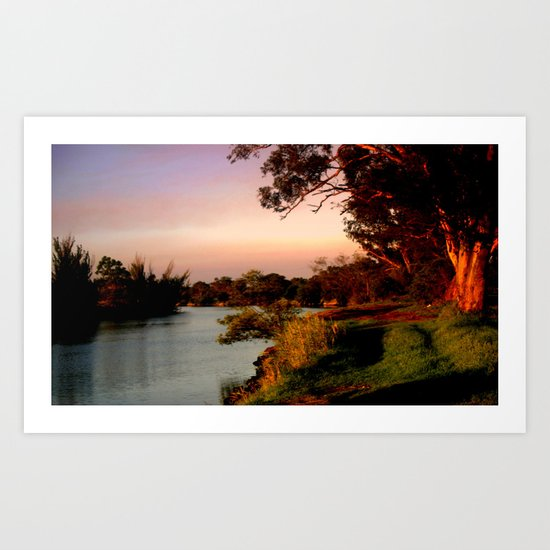 Reflecting sunset on the river Bank Art Print