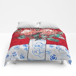 Delft Bird Vase of Proteas on Red Comforters