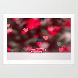 red car on the table at the love background Art Print