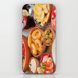 II - Assortment of Spanish tapas and sangria on a rustic table iPhone Skin