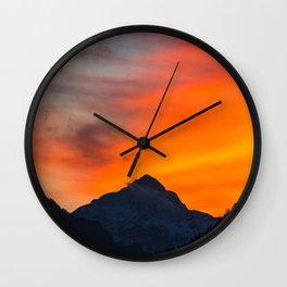 Stunning vibrant sunset behind mountain Wall Clock