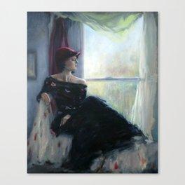 Woman sitting by window Canvas Print