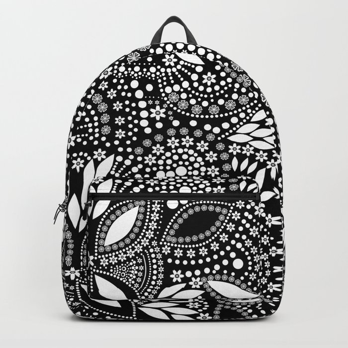 Placer of white beads on a black background . Backpack