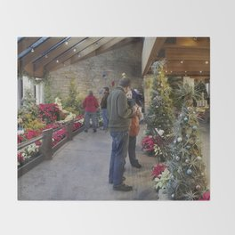 Festive flower show with model trains and buildings Throw Blanket