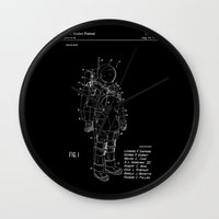 nasa Wall Clocks featuring NASA Space Suit Patent - White on Black by Elegant Chaos Gallery