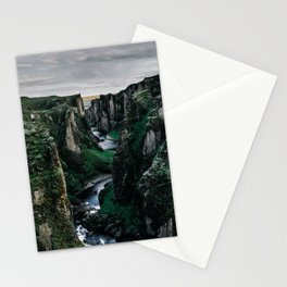 Fast flowing river making (wending) it's way between two massive rock formations Stationery Cards