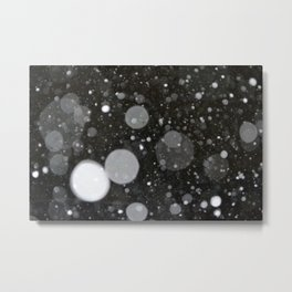 Light in the Dark-Photo of light colored circles on a dark surface Metal Print