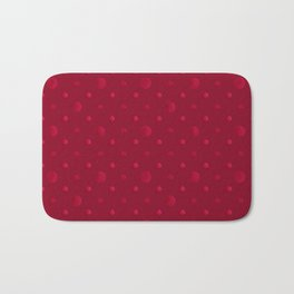 Red polka dots on a red background . Bath Mat