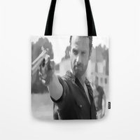 rick grimes Tote Bags featuring Rick Grimes by OliGilbert