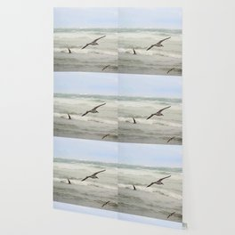 Seagulls flying over rough sea Wallpaper